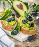 Avocado sandwich and blueberry on the wooden Stock Photography