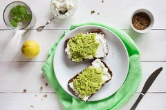 Avocado sandwich with cottage cheese overhead Stock Photos