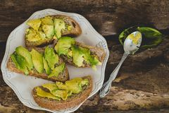 Avocado sandwich on the table Stock Photography