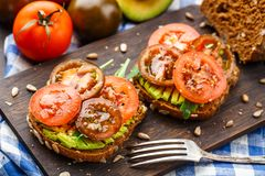 Avocado sandwich with tomatoes Stock Photos
