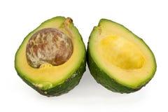 Avocado schnitt in Hälften lizenzfreies stockbild
