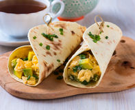 Avocado scrambled egg wraps. Homemade avocado scrambled egg wraps for healthy breakfast Stock Photo