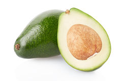 Avocado and section isolated on white. Clipping path Stock Photography
