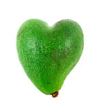 Avocado shaped like heart. Healthcare concept Royalty Free Stock Photos