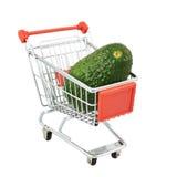 Avocado in a shipping cart Royalty Free Stock Photos