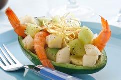 Avocado with shrimp and fruit Stock Image