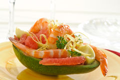 Avocado with shrimp and grapefruit Royalty Free Stock Photo