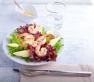 Avocado shrimp salad with mustard sauce. On the table Stock Photography