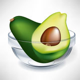 Avocado and slice in bowl Stock Photography
