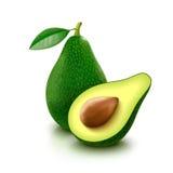 Avocado with slice on white background. Whole avocado with leaf and slice  on white background Stock Photography