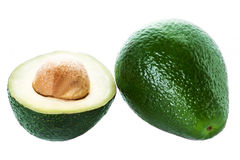 Avocado slice and whole ripe green avocado fruit  isolated on a Royalty Free Stock Images