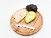 Avocado and sliced bread Stock Images