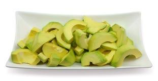 Avocado. Sliced Avocado on a white plate Royalty Free Stock Photography