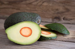 Avocado sliced on wood Royalty Free Stock Photo