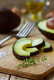 Avocado slices with olive oil, herb thyme and garlic Royalty Free Stock Photography