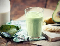 Avocado smoothie. With all ingredients on table Royalty Free Stock Photo