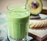 Avocado smoothie. With all ingredients on table Stock Image