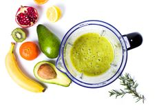 Avocado smoothie in a blender with various ingredients. Top view Stock Photography