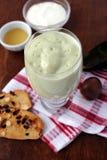 Avocado smoothie made with yogurt. Milk and honey Royalty Free Stock Photos