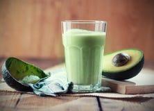 Avocado smoothie. With sliced avocado on table Stock Image