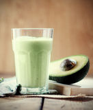 Avocado smoothie. With sliced avocado on table Royalty Free Stock Image