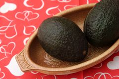 Avocado. Some black avocado in a brown bowl stock photography