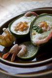 Avocado soup with physalis-shrimp salsa Royalty Free Stock Photography