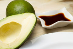 Avocado with soy sauce Stock Images