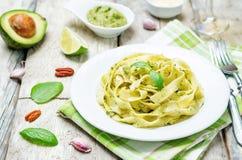 Avocado spinach basil pecan pesto pasta Stock Images