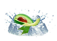 Avocado splash and ice. Cubes isolated on white background royalty free stock photography