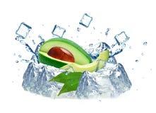 Avocado splash and ice. Cubes isolated on white background royalty free stock photos
