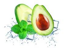 Avocado ice splash. Avocado splash ice water isolated on white royalty free stock photos