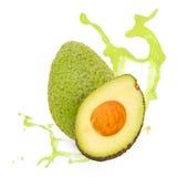 Avocado splash. Photo of avocado with slice and splash isolated on white royalty free stock photos