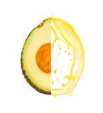 Avocado splash. Photo of avocado with slice and splash isolated on white stock photos
