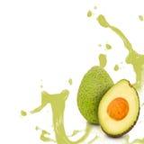 Avocado splash. Photo of avocado with slice and splash isolated on white stock image