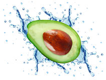Avocado splash. Avocado slice splash isolated on white background royalty free stock photos