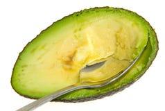 Avocado with a Spoon Royalty Free Stock Photos