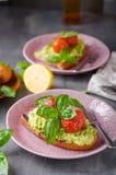 Avocado spread bread with baked tomato Royalty Free Stock Photography