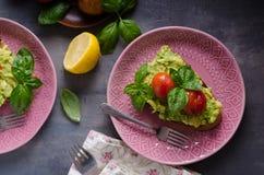 Avocado spread bread with baked tomato Royalty Free Stock Photo
