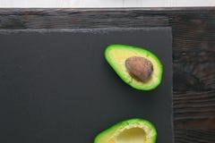 Avocado on stone board Stock Photography