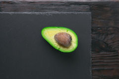 Avocado on stone board Royalty Free Stock Photos