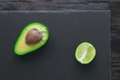 Avocado on stone board Royalty Free Stock Image