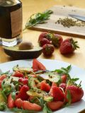 Avocado with strawberries Stock Images