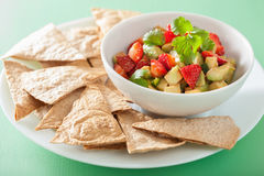 Avocado strawberry salsa with tortilla chips Stock Images