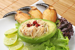 Avocado stuffed with crab Stock Photo