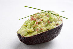 Avocado stuffed with guacamole Royalty Free Stock Photos