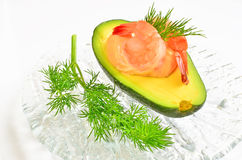 Avocado stuffed with prawns Royalty Free Stock Photo