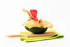 Avocado with Swiss cheese Royalty Free Stock Image
