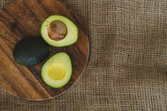 Avocado on the table Stock Images