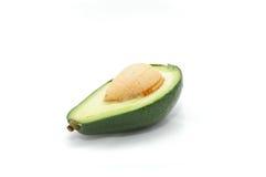 Avocado, taglio isolato su una priorità bassa bianca Immagini Stock